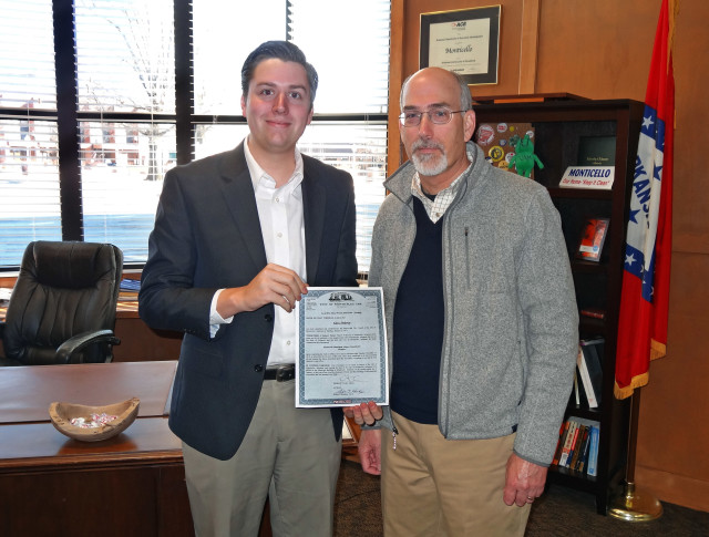 January 22, 2015 - The Monticello City Council approved the appointment of EFS President, Glen Dabney, to serve on the City's Airport Commission. Pictured above Monticello's Mayor Zack Tucker (left) presents Glen Dabney (right) with the appointment resolution from the City Council.